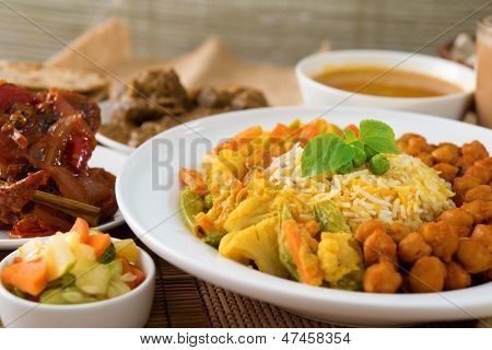 Biryani rice or pilau rice with curry, fresh cooked basmati rice with spices, delicious Indian food. poster