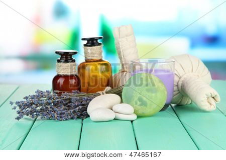 Still life with lavender candle, soap, massage balls, soap and fresh lavender, on bright background