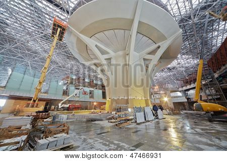 MOSCOW - NOV 29: Articulating booms, scissor and telescopic lifts at construction site of new terminal at Domodedovo Airport, November 29, 2012, Moscow, Russia.