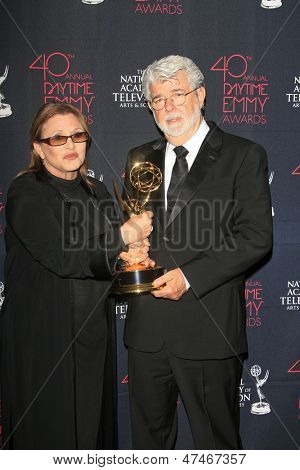 BEVERLY HILLS - JUN 16: Carrie Fisher, George Lucas with their award for 'Star Wars: The Clone Wars' at the 40th Annual Daytime Emmy Awards on June 16, 2013 in Beverly Hills, CA