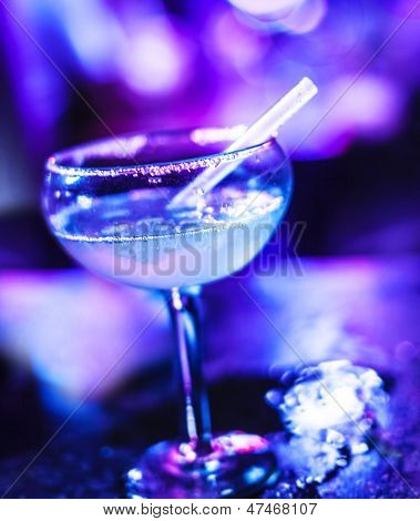 Frozen Margarita cocktail, alcoholic beverage in the bar, sweet tasty booze in neon light in the pub, holiday celebration, luxury night life