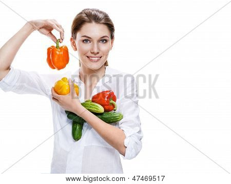 promo girl holding a paprika and cucumbers - isolated on white background