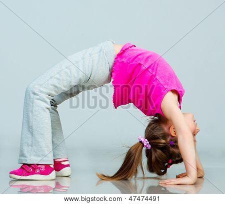 Little girl doing gymnastics exercise