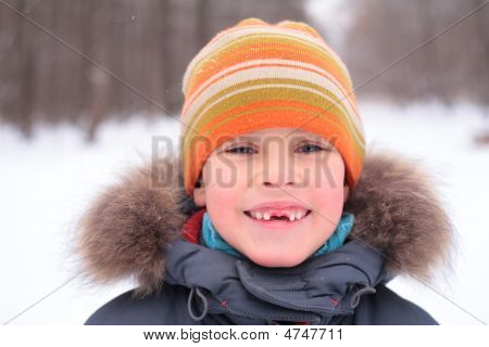 Smiling Boy Without Foreteeth