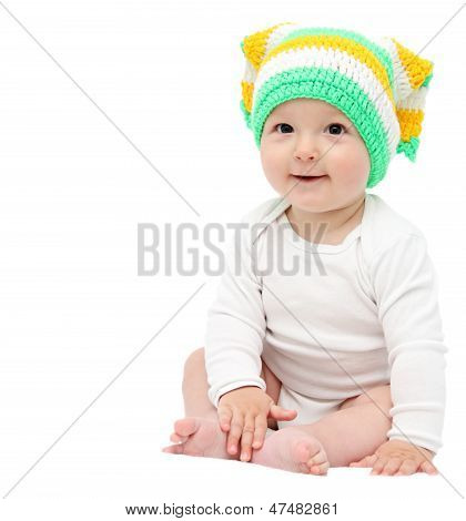 Beautiful Happy Baby Boy Sitting On White Bed