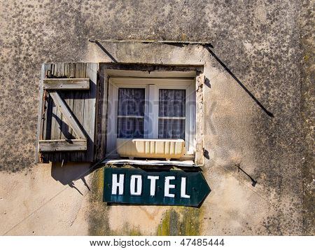 a sign saying hotel mclick a house. poster