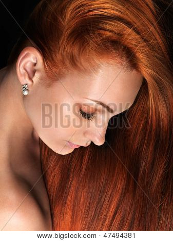Beautiful woman with long red hair