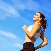 Beautiful young woman runner having a workout session. poster