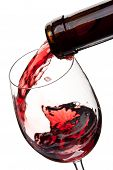 Red wine poured in a glass isolated on a white background poster