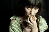 portrait of a poor beggar woman eating bread poster