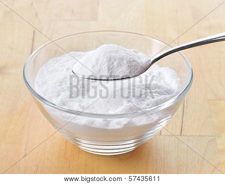 Close-up Of Baking Soda On Spoon.