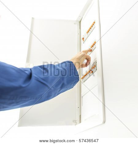 Man Checking The Electrical Fuse Box