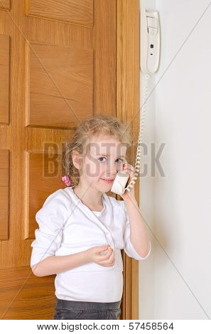 Little girl talking on the intercom at home. poster