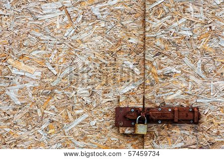 Metal lock on an abstract background of wood chips poster