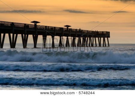 Jacksonville Beach Pier at sunrise with fisherman. poster