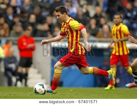 BARCELONA - MARCH, 29: Leo Messi of FC Barcelona in action during a Spanish League match against RCD Espanyol at the Estadi Cornella on March 29, 2014 in Barcelona, Spain