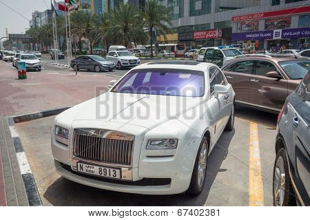 DUBAI, UAE - MARCH 31: Rolls-Royce Ghost on the street of Deira in Dubai on 31 March 2014, UAE. Dubai is one of the richest cities in the world with many luxury cars on streets.