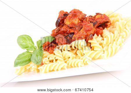 Fusilli pasta with pork & eggplant sauce on a white background