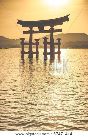 Miyajima Famous big Shinto torii standing in the ocean in Hiroshima Japan poster