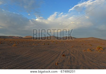 Rainbow Amongst Sand Dunes In The Amargosa Desert