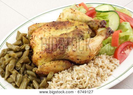 Kräuter geröstete Kornische Henne mit Reis