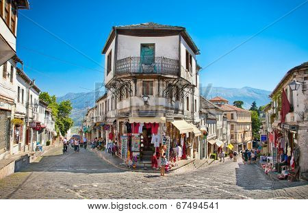 GJIROKASTER, ALBANIA - JUNE 07, 2014: Unidentified locals in a street scene at the center of historic town of Gjirokasteron June 07, 2014 in Gjirokaster, Albania. World Heritage Site by UNESCO