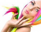 Beauty Girl Portrait with Colorful Makeup, Hair and Nail polish. Colourful Studio Shot of Woman face closeup. Vivid Colors. Manicure and Hairstyle. Rainbow Colors manicure  poster
