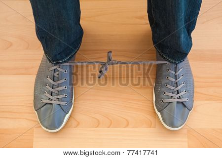 April fools with shoelaces of trainers at home