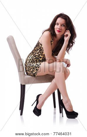 Woman sitting on the chair isolated on white
