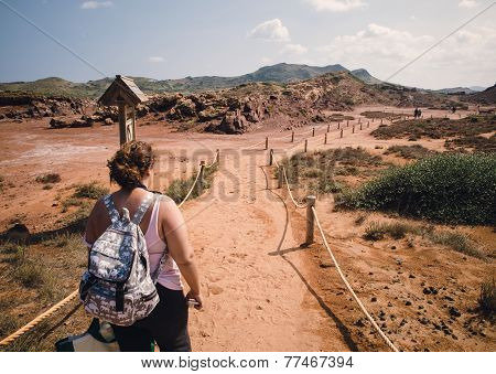 Woman In A Path In A Dessertic Landscape