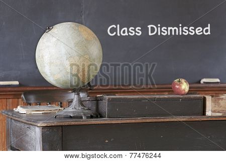Class Dismissed message on blackboard in old vintage schoolhouse poster
