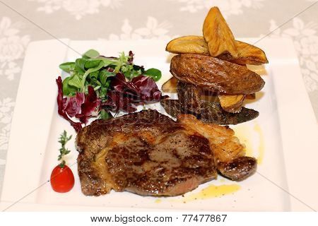 Pork meat with potatoes and salad