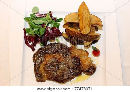 Pork steak with herbs and tomato