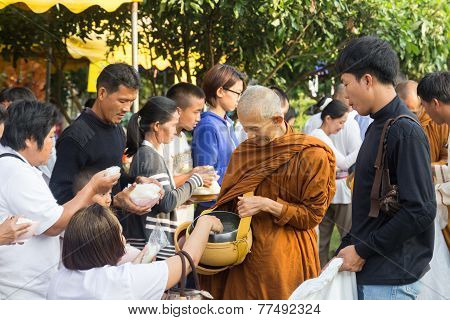 People Put Food Offerings In A Buddhist Monk's Alms Bowl For Virtue