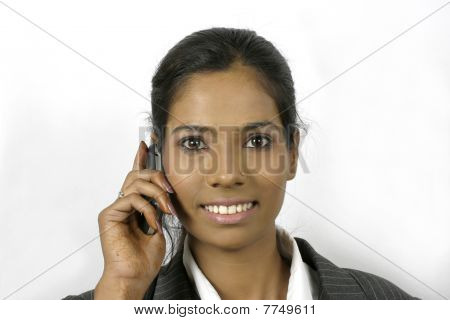 indian business woman talking on mobile phone