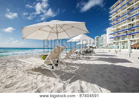 Caribbean Beach With Sun Umbrellas And Beds