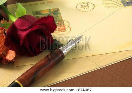 Vintage Postcard And Red Rose