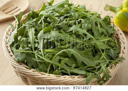Basket with fresh raw arucola salad