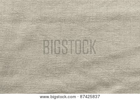rough woven abstract texture of textile fabric of beige color for empty and pure backgrounds poster