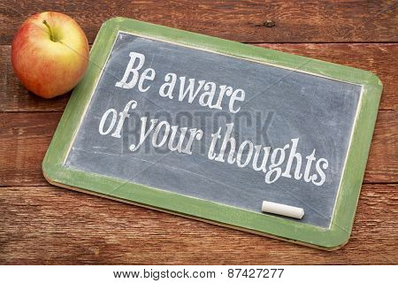 Be aware of your thoughts - inspirational  words on a slate blackboard against red barn wood