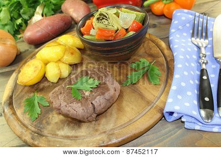 Roasted Ostrich Steak With Baked Potatoes And Parsley