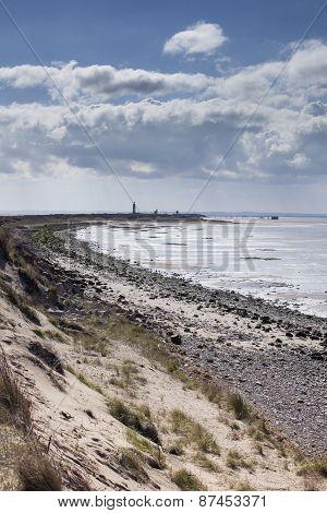 Spurn Point Coastline With Lighthouse