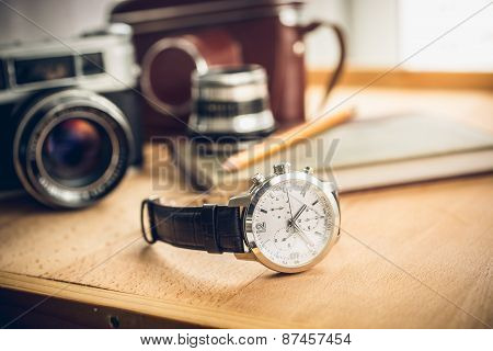 Male Watches Lying On Table Against Photography Retro Set