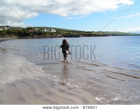 Paddling On A Sunny Beach