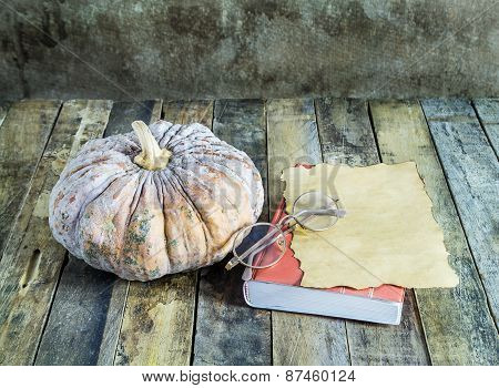 Pumpkin Old Paper And Notebook On Wooden