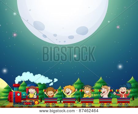 Train ride at night with fullmoon background