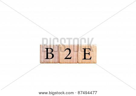Acronym B2E - Business to employee. Wooden small cubes with letters isolated on white background with copy space available. Business Concept image. poster