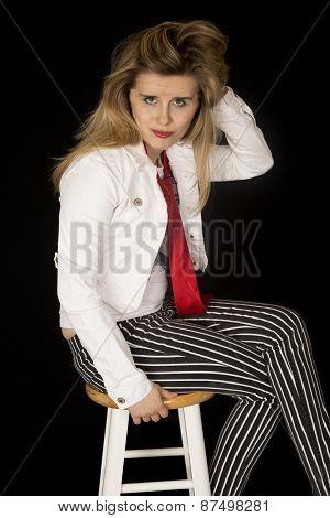 Girl With An Attitude Sitting On A Bar Stool
