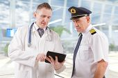 Commercial airplane pilot with doctor  poster