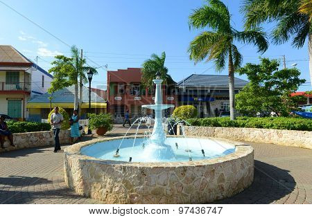 FALMOUTH, JAMAICA - DEC 29, 2014: Falmouth Water Square is the busy hub of Falmouth in Falmouth, Jamaica. Falmouth boasted running water before New York  City in 1798.